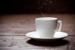 Coffee cup and saucer on old wooden table. Royalty Free Stock Images