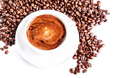 Coffee cup and saucer with roasted coffee beans isolated on a wh Stock Photography