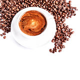 Coffee cup and saucer with roasted coffee beans isolated on a Stock Images