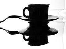 Coffee Cup,Saucer and Spoon. Black and white photo of a coffee cup,saucer and spoon with distorted reflection Stock Photography