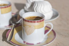 Coffee cup saucer and spoon. Stock Photography