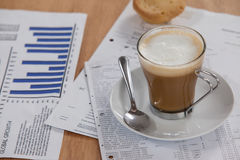 Coffee cup with saucer, spoon and documents Stock Photo
