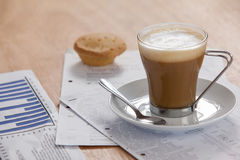 Coffee cup with saucer, spoon and documents Stock Photos