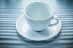 Coffee cup saucer on striped background Royalty Free Stock Image