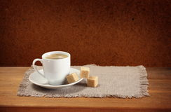 Coffee cup, saucer, sugar, napkin Stock Image