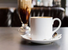 Coffee cup and saucer on the table Royalty Free Stock Image