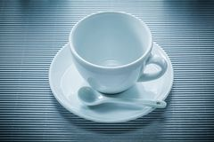 Coffee cup saucer teaspoon on striped background.  Royalty Free Stock Images