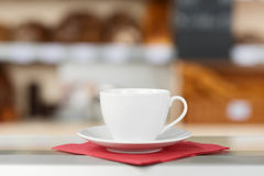 Coffee Cup And Saucer On Tissue Paper Stock Images