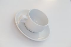 Coffee cup and saucer Stock Images