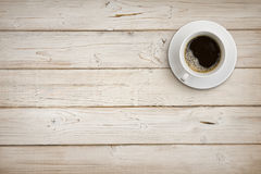 Coffee cup with saucer on wooden planks background, top view Royalty Free Stock Photos