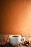 Coffee cup and saucer. On a wooden table Stock Photography