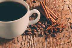 Coffee cup and saucer. On a wooden table royalty free stock photos