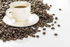 Coffee cup and saucer on a wooden table. Stock Image