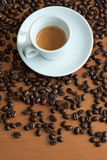 Coffee cup and saucer on a wooden table Royalty Free Stock Images