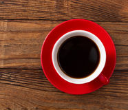 Coffee cup and saucer on  wooden table. Royalty Free Stock Photography