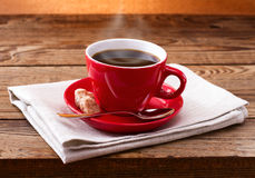 Coffee cup and saucer on  wooden table. Royalty Free Stock Image