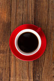 Coffee cup and saucer on  wooden table. Stock Photography