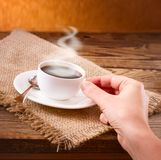 Coffee cup and saucer on  wooden table. Stock Image
