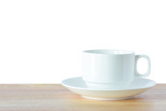 Coffee cup and saucer on wooden table Stock Photos