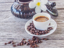 Coffee cup and saucer on a wooden table Stock Image