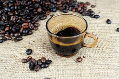 Coffee cup with scattered coffee beans Stock Photos
