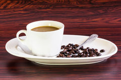 Coffee with cup and seeds Stock Images