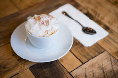 Coffee cup served on wooden table in cafeteria Royalty Free Stock Photo