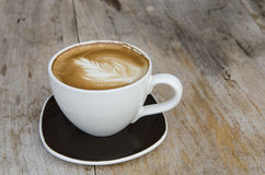 Coffee cup on the shabby wood background Royalty Free Stock Photo