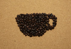Coffee cup in the shape of a coffee bean Royalty Free Stock Photography