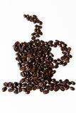 Coffee cup shaped figure made out of coffee beans against white background Stock Photography