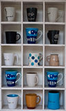Coffee cup Shelf. On wall Royalty Free Stock Photography