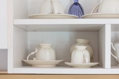 Coffee cup on shelf. In home Stock Photos