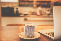 Coffee cup in coffee shop with vintage filter. royalty free stock photo