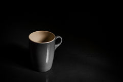 Coffee cup. A shot of a coffee cup shot over a black background Royalty Free Stock Images