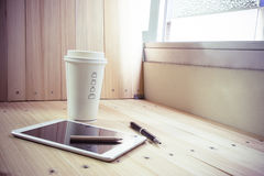 Coffee cup with  shutdown tablet, relax time Royalty Free Stock Images