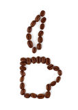 Coffee cup sign. Made of coffee seeds on the white Stock Photography
