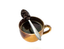 Coffee cup with silver spoon Stock Photography
