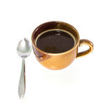 Coffee cup with silver spoon Stock Images