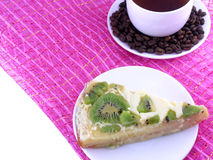 Coffee cup and slice of kiwi tart Royalty Free Stock Images
