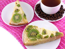 Coffee cup and slice of kiwi tart Stock Photography