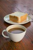 Coffee cup with sliced bread on table. Coffee cup with sliced bread on wood table Stock Photos