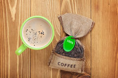 Coffee cup and small bag with beans Stock Images