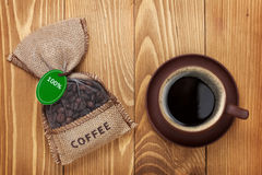 Coffee cup and small bag with beans Stock Image