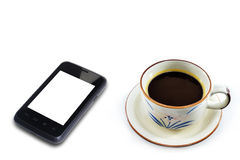Coffee cup and smartphone Royalty Free Stock Image