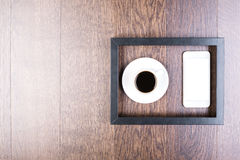 Coffee cup and smartphone inside frame Stock Photo