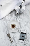 Coffee cup, smartphone, key and coffee maker Stock Photo