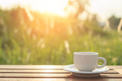 Coffee cup and smartphone on the table in the morning Royalty Free Stock Photos