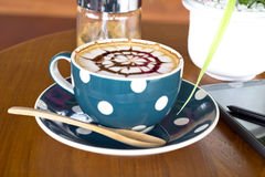 Coffee cup and smartphone Royalty Free Stock Photography