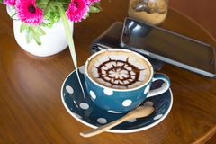 Coffee cup and smartphone Stock Image
