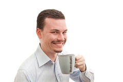 Coffee cup smile. Young caucasian male happily drinking coffee Stock Images
